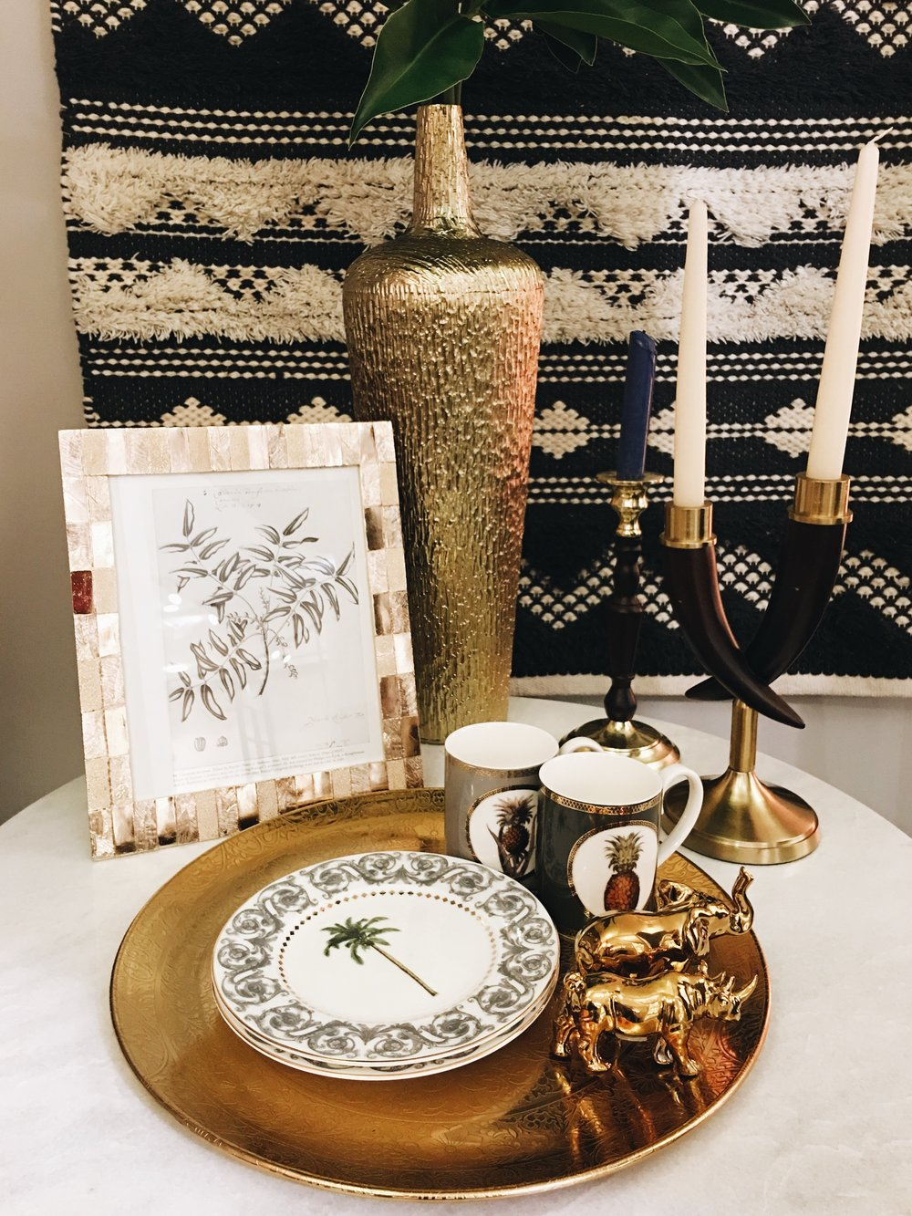 Palm trees and pineapples are given a more sophisticated edge at M&S for SS17. Mugs, £6. Tall Afia Vase, £39.50. Wood and brass candle stick, £17.50. All other items TBC.