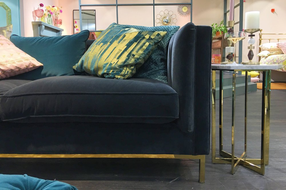 Dante Large Sofa in Velvet Graphite, £2099. Cushions from a selection, £25. Ava side table, £175. Bellagio champagne saucers, £19.50 for two. All M&S.
