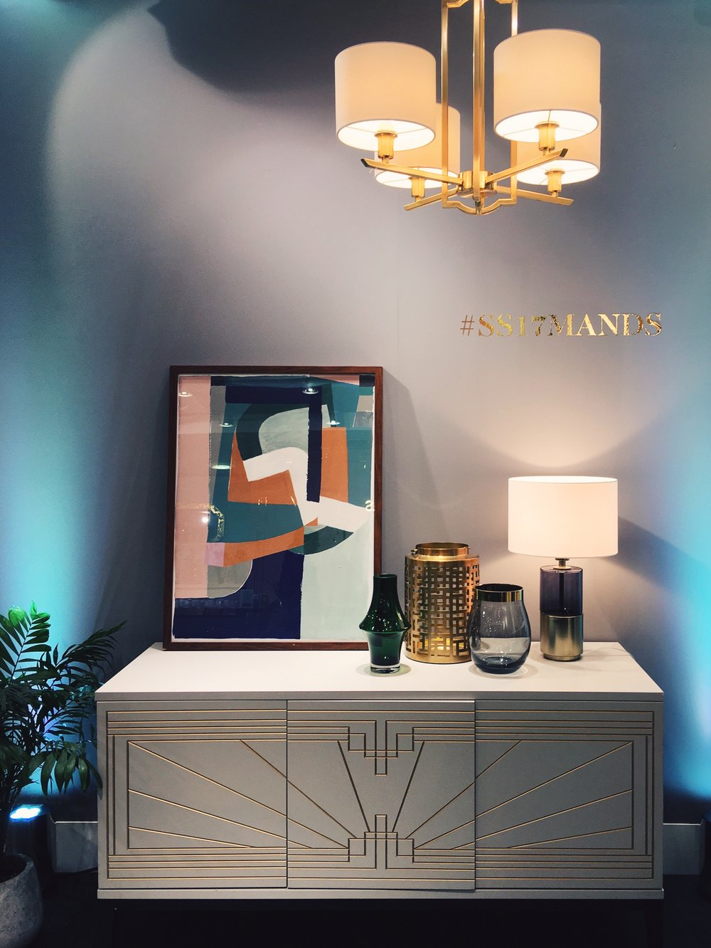 Stella 4 light Chandelier, £129. Carraway Sideboard, £849. Hustle Print (framed), £55. Conran Corin Table Lamp, £89. Conran Small Glass Hurricane, £25. Deco Lantern, £25. All part of the 'Luxe Revival' range at M&S.