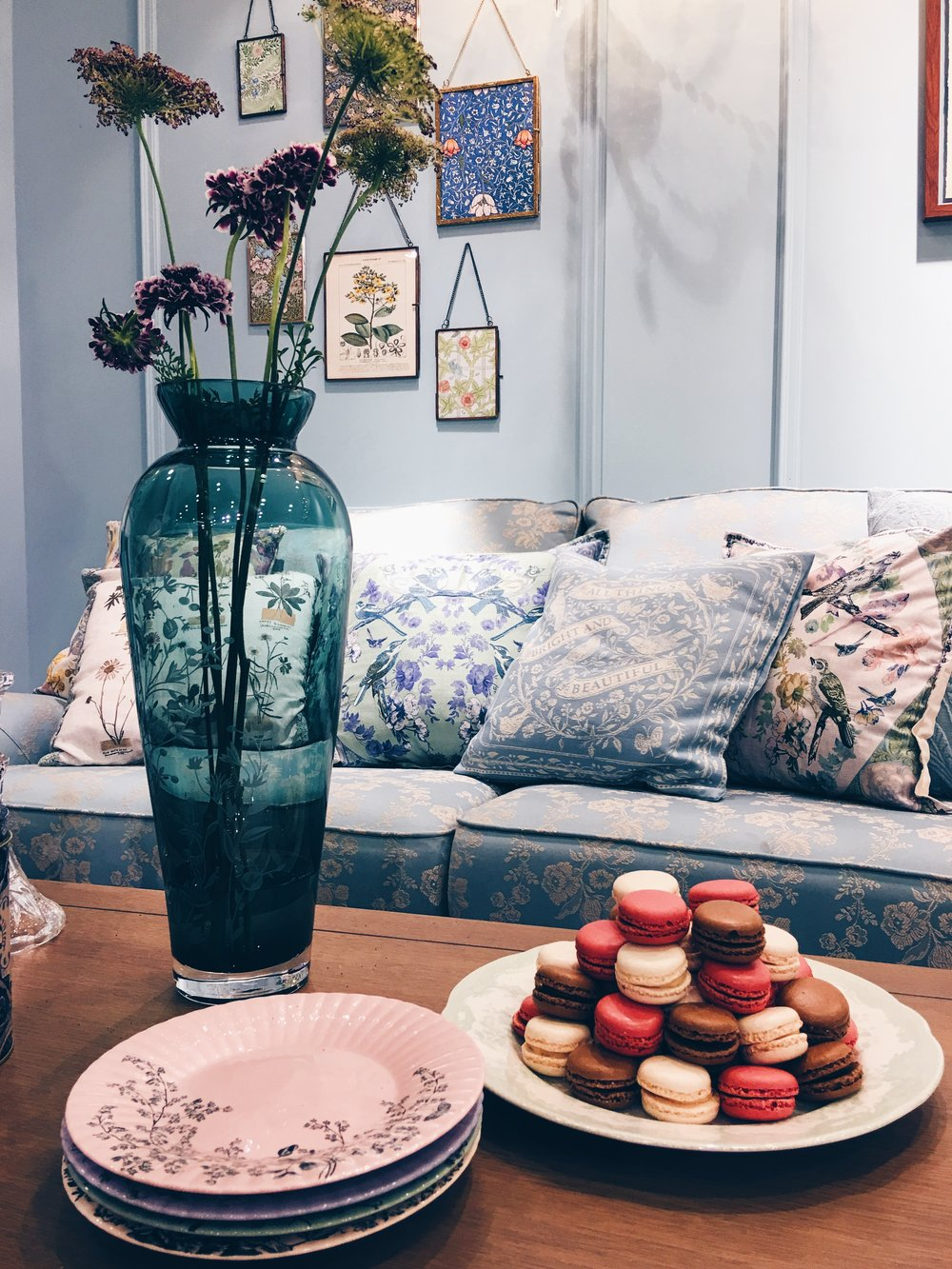 These items made up the M&S 'Soft vintage' collection. Georgia sofa in Blue Floral Jacquard, £1399. Vase & plates, price TBC. Cushions, from a selection, £25 each. William Morris prints and hanging frames, from £12-£25. All M&S.