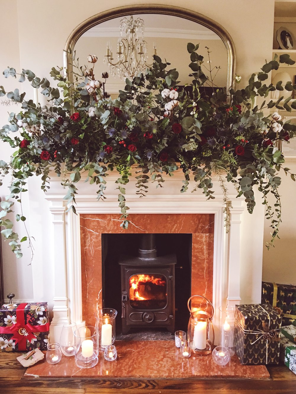 I've gone all out this year with a real flower fire surround garland!