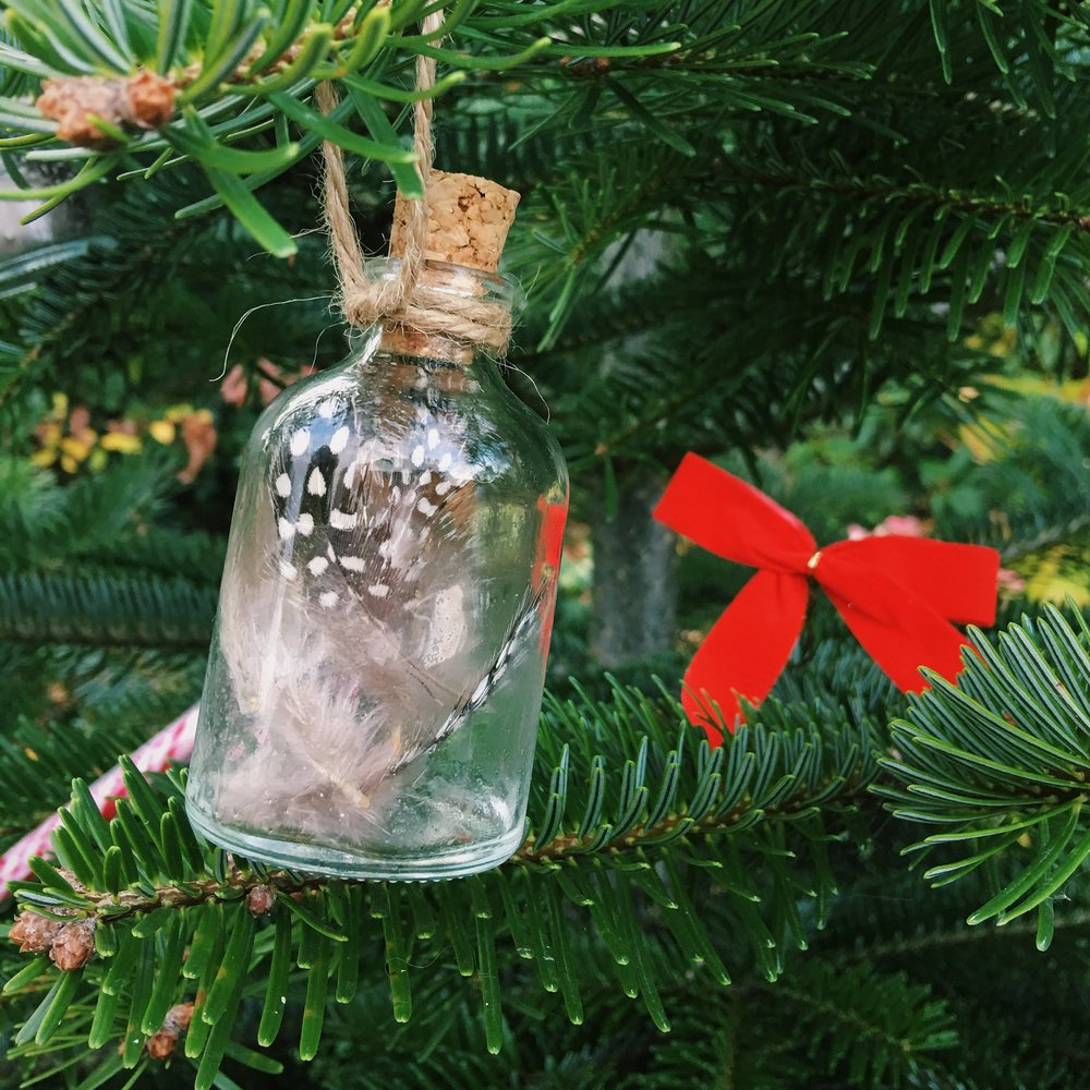 These glass and feather tree decorations are easy and cheap to make.
