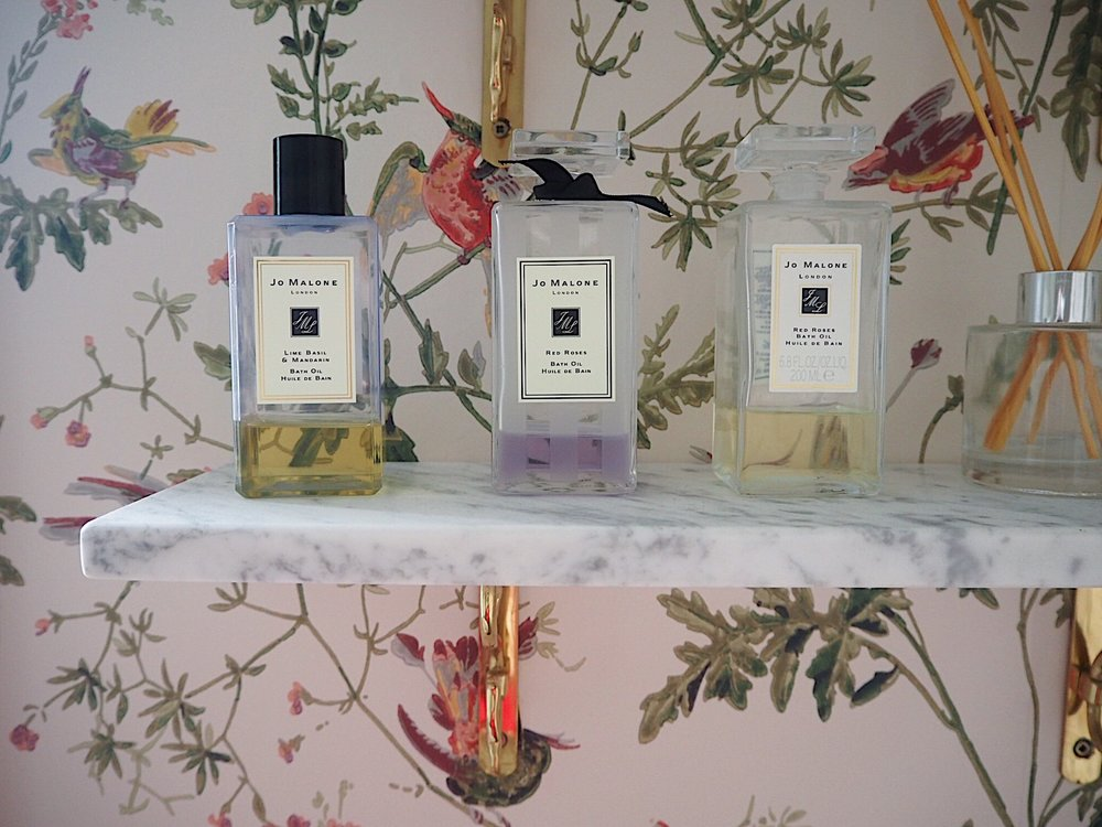 I've displayed luxurious bath products to make the bathroom feel more 'special'. Buy  Jo Malone bath oil  from  John Lewis.