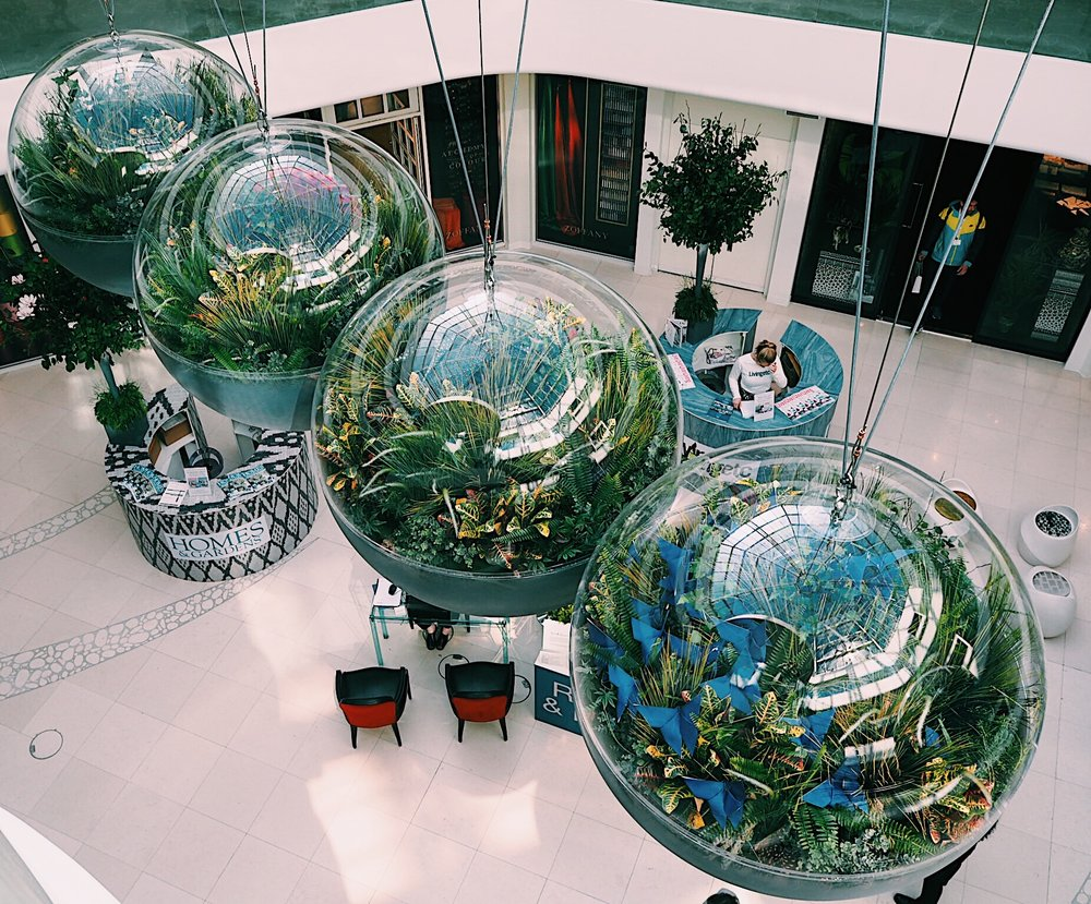Perhaps the best example of science + nature within great design was this giant Newton's cradle structure (complete with on-trend large terrariums), that could be found inside the Design Centre.