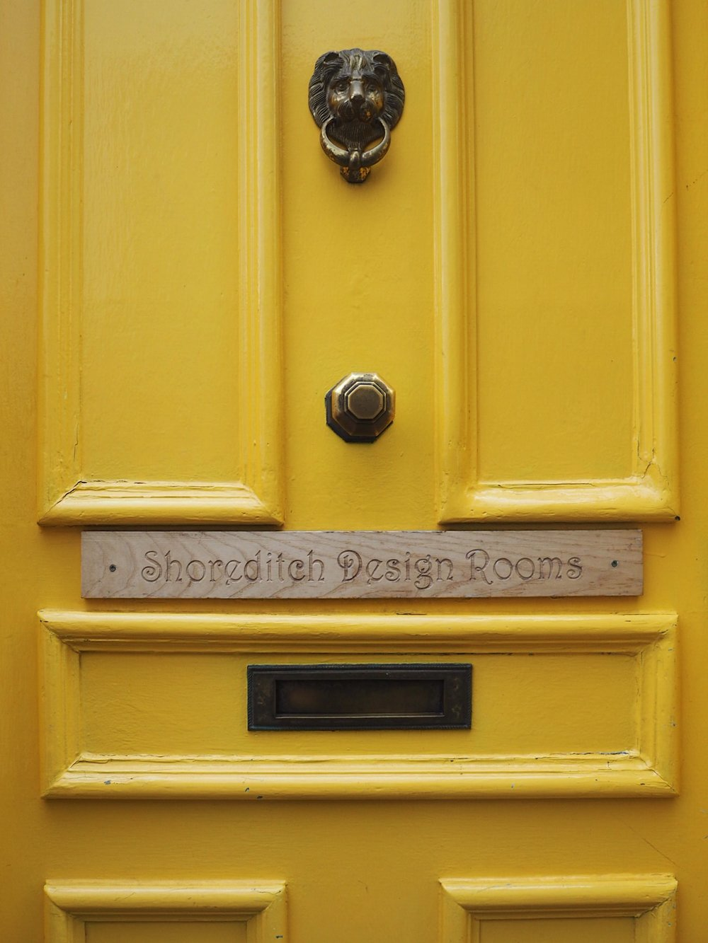 The carved wooden sign was the first give-away that behind this beautiful yellow door was a hub of creativity and craftsmanship.