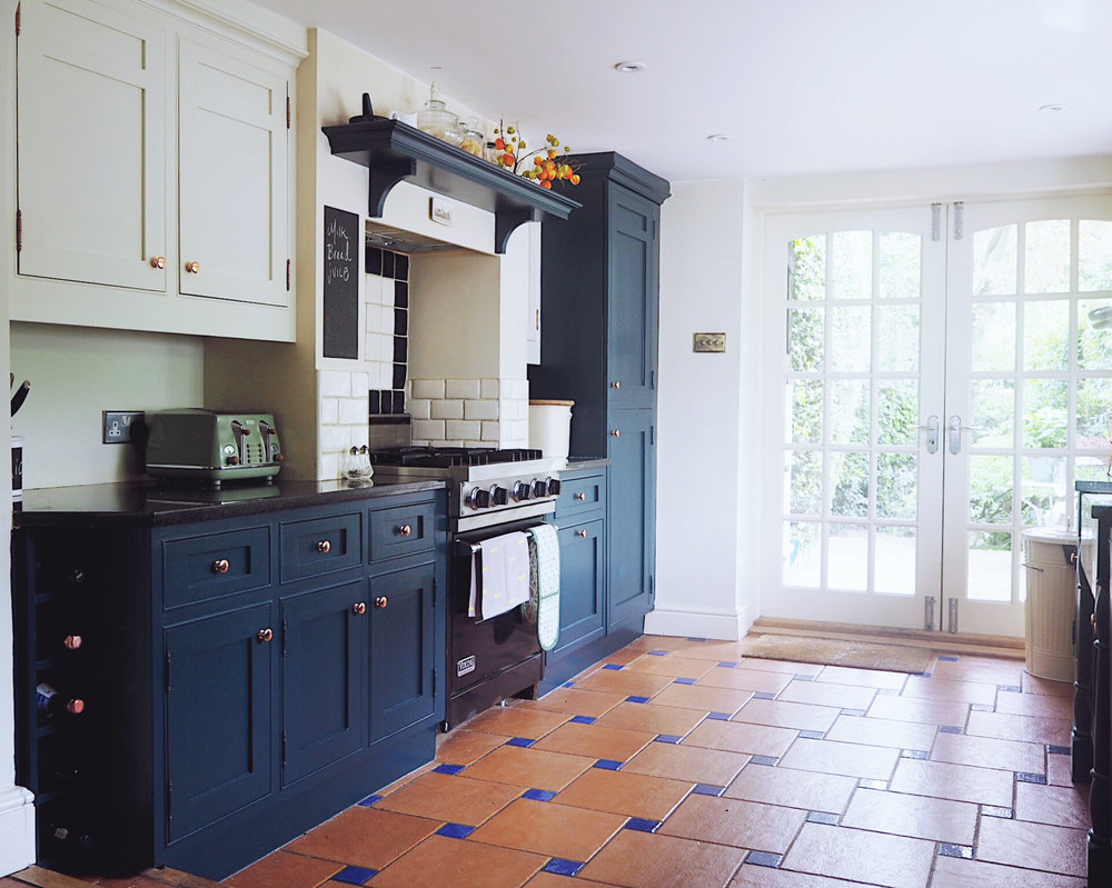 How my kitchen looks now, with base units painted in Hague blue, and top units painted in Clunch, both Farrow & Ball.