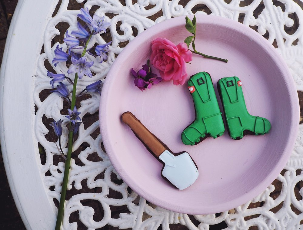 Tray in Kyoto Blossom, Designers Guild paint. Wellie and spade chocolate biscuits from the 'Green Fingers' biscuit tin by Biscuiteers.