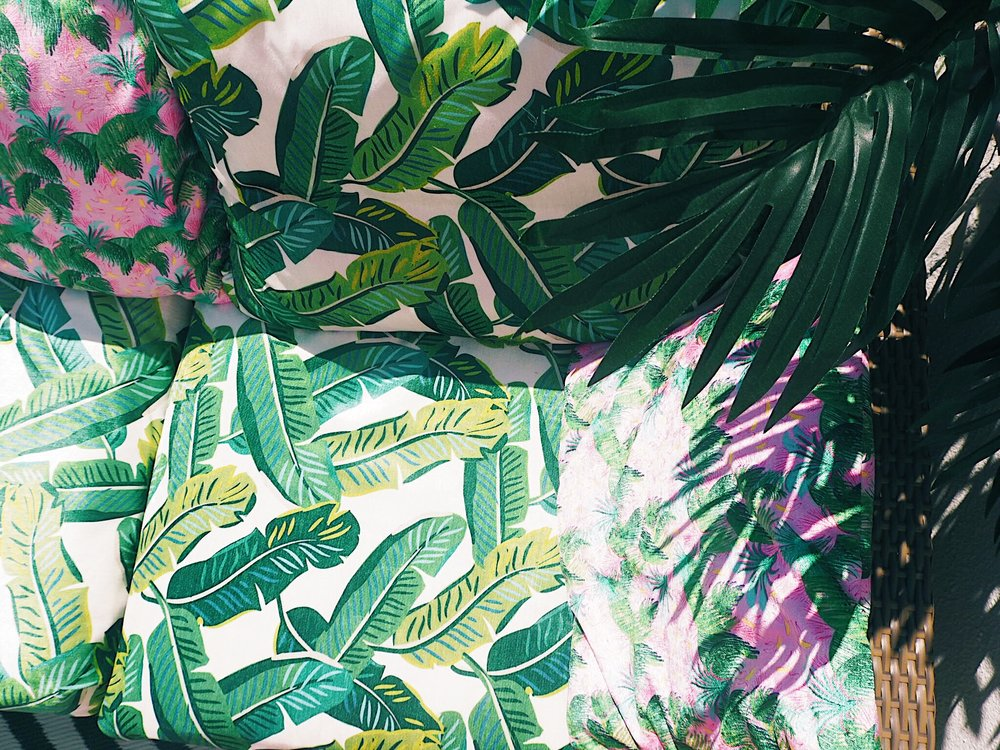 The tropical leaves from this  Wayfair faux tree  over the leaf-print sofa transports me from Essex to somewhere much more tropical!