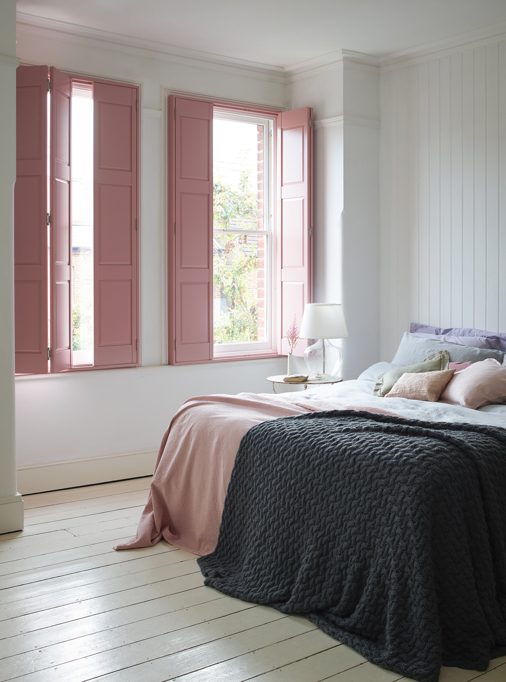 Blush pink is not going anywhere in 2018. I love how the pink of these Shutterly Fabulous wood panel shutters complement the femininity   of this room scheme.