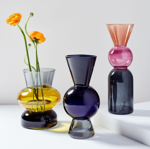 Colourful Shaped Glass Vases - Either coloured glass is on-trend right now, or I'm just really drawn to it! The next three items on my 'must-have' list are all made from coloured glass and are all gorgeous! Lets start with these retro Totem Vases by West Elm, which would look ace with the sun shining through them on a window sill.Totem Glass Coloured Vases, From £29, West Elm.