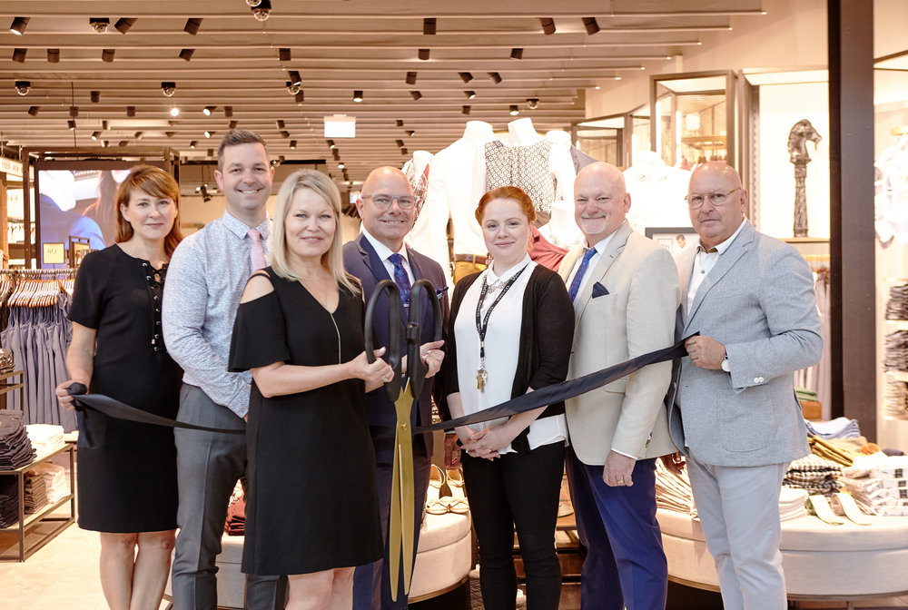Lora Tisi (front and centre),President, RW&CO.,Walter Lamothe (second from right),President - Retail and Chief Operating Officer, Reitmans Canada Ltd. and Michele Slepekis (far left),Vice-President, Marketing and Visual Presentation