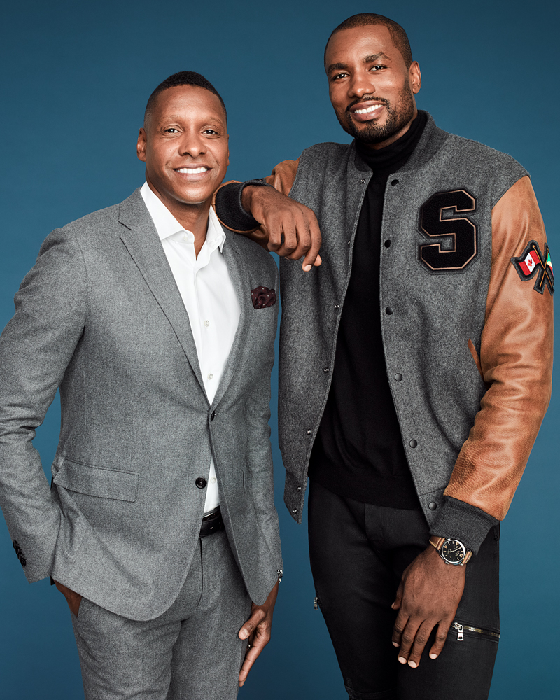 On Masai: Suit ($4,100) by Harry Rosen MTM. On Serge: Custom varsity jacket by Roots Canada; turtleneck ($425) by Z Zegna, available at Saks Fifth Avenue; watch ($15,900) by Panerai.