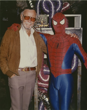 "Stan Lee posing with ""Spider-Man"" in 1994"