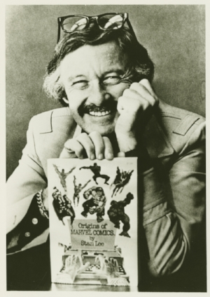 Stan Le e holding  Origins of Marvel Comics