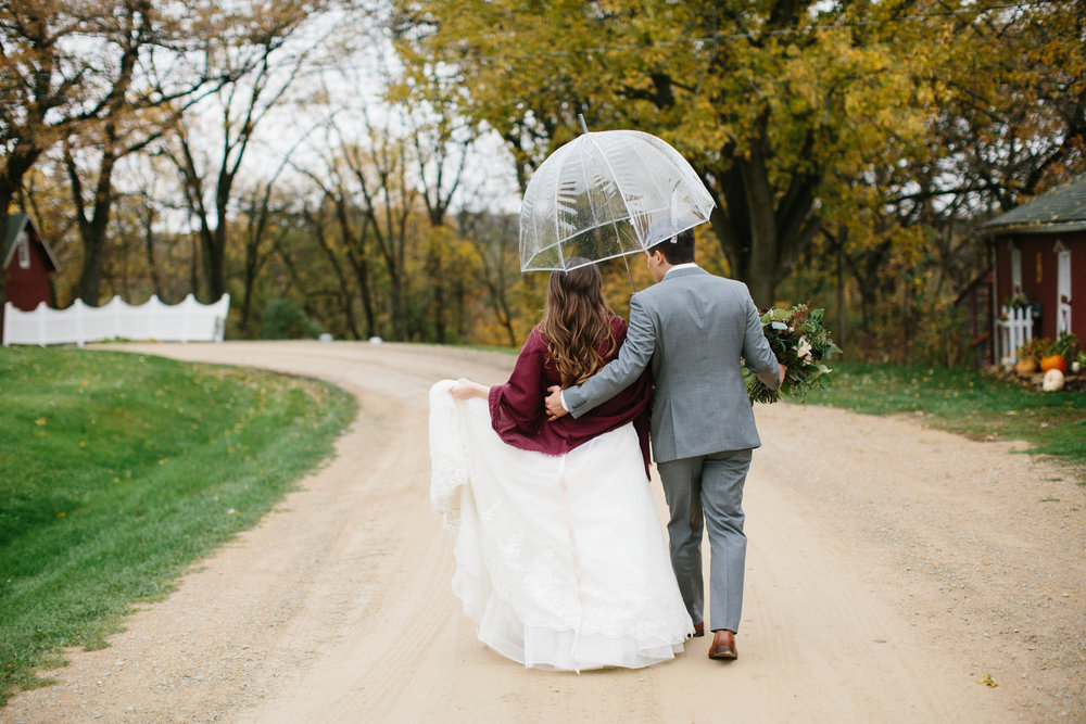 It rained pretty much our whole wedding day. Connor and I went with it!