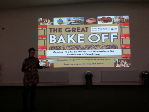 'Dr.Jane presenting the Bake-Off Event to the college staff' - 'this was part of a power-point presentation about the work of Extra Mile'.