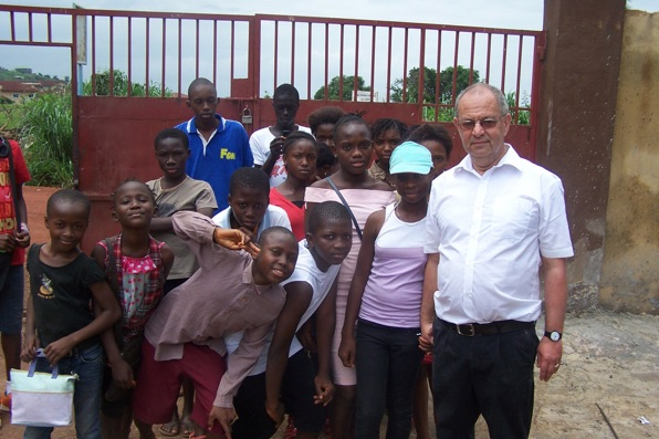 Martin with his pupils at Agape School gates