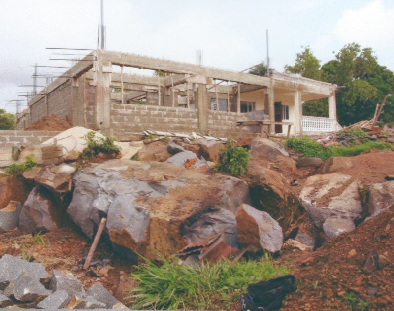 Aug 2014 - Breaking huge boulders to level school site.