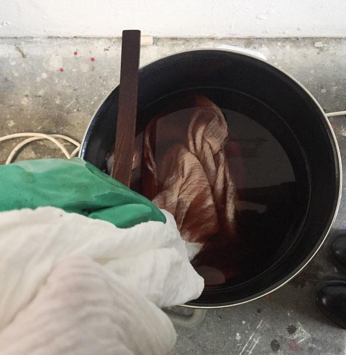 Soaking fabric in dye