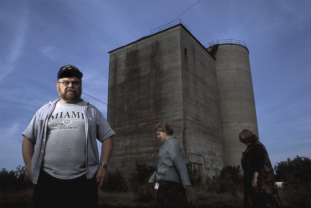 Man next to cement towers.jpg
