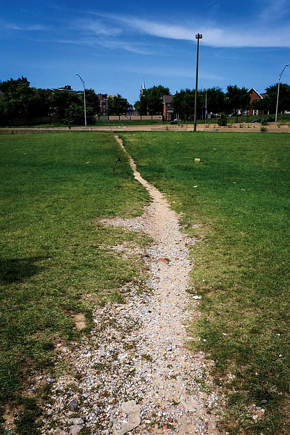 """A """"desire line"""" formed along the meridian of U.S. Route 40 in West Baltimore."""