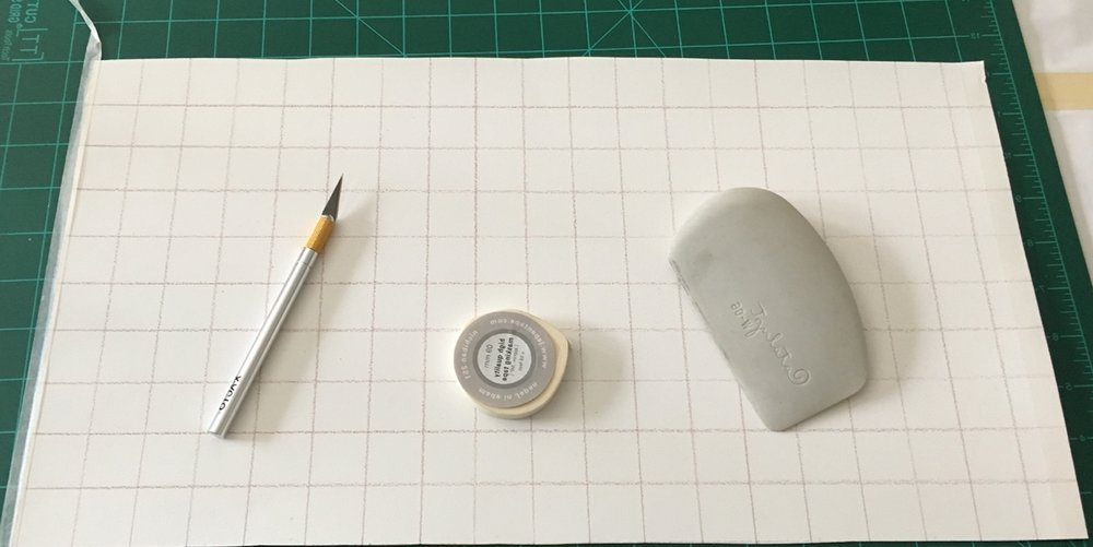 Paper, cutting mat, Xacto knife, masking tape, plastic scraper