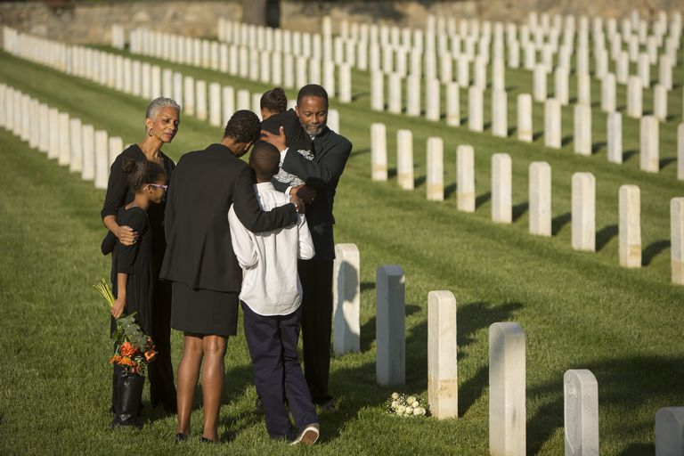 multi-generation-black-family-hugging-in-military-cemetery-672154195-59595ea33df78c4eb63ddff5.jpg
