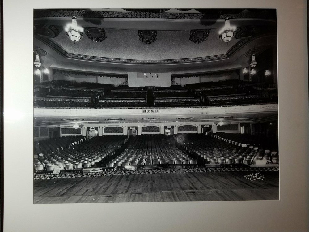 The print hanging on the wall in the Orpheum Theatre photographed with Lisa's smartphone.