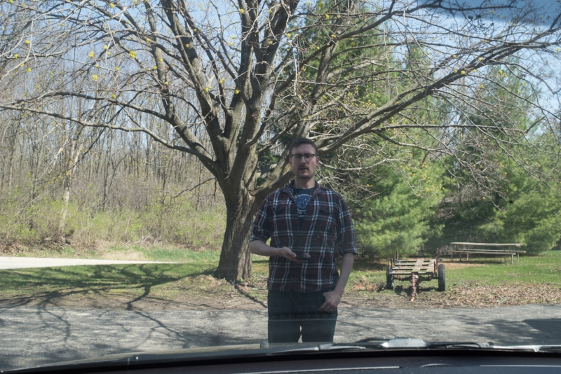 Taken from inside the van, this image shows investigator Tobias Wayland standing in the approximate location the witness said he saw the creature.