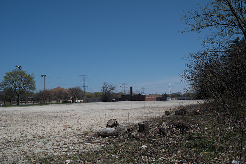 View across the parking lot of the street and developed area to the east.