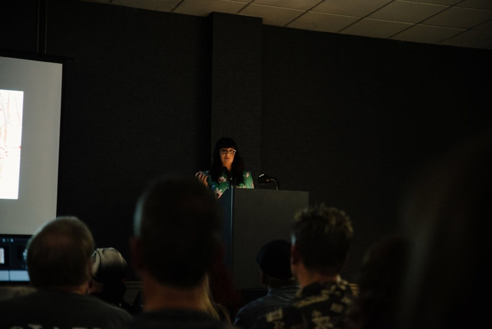 Sarah Chavez talking about the ritual connection between food, death, and the afterlife in human culture during her presentation  Feeding the Dead -Food in Death Rituals, Ancestor Worship, and Festivals.