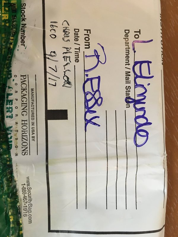 A shipping label that appears to be addressed to Elizondo.