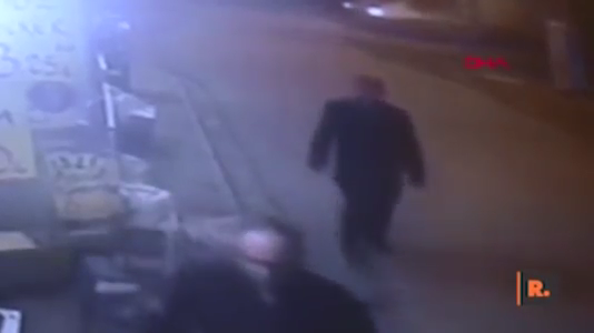 A still image from CCTV footage that shows the mystery man approaching Binici'yi from behind.  (Image credit: Gazete Duvar / YouTube)