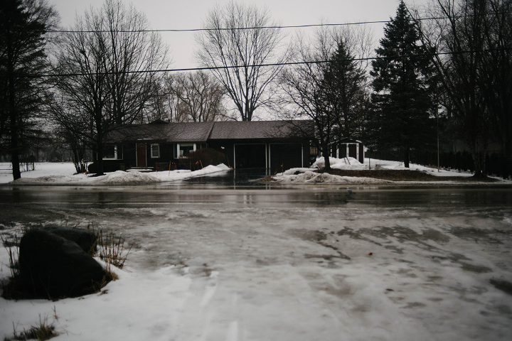 Directly across the street from the entrance. The witness lost sight of the creature almost immediately after it left the illumination of his car's headlights, but it may have crossed along the treeline to the reader's right of this house and into the McHenry County Fairgrounds—which leads into fields and more natural areas.  (Emily Wayland / Singular Fortean Society)
