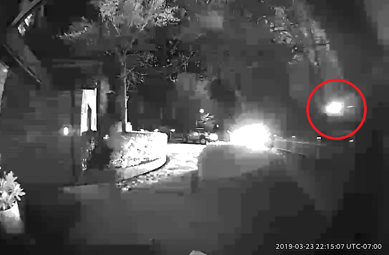 A still image taken from a resident's home surveillance camera video. Circled is a mysterious flash of light that appears just before the boom that authorities suspect could be caused by explosives.