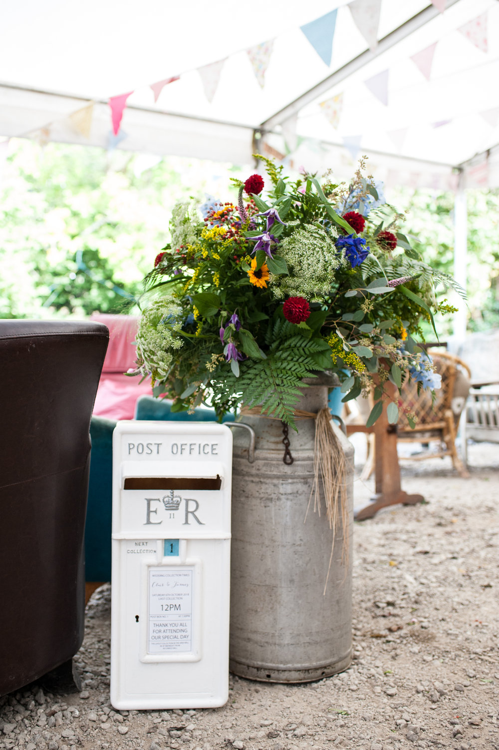 post box available to hire from  the wedding hub . floral arrangement from escential blooms