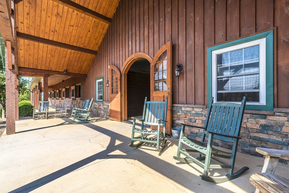 After spending time with your horse, Relax in the rocking chairs on our front porch overlooking the rolling hills of Maryland