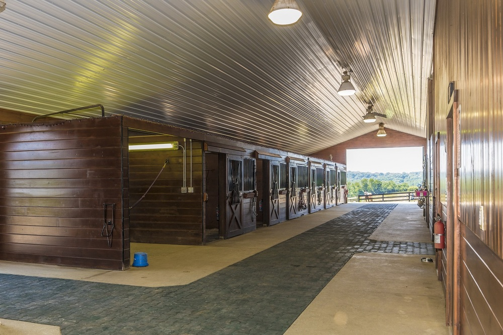 Our extra wide barn AISLE makes MANEUVERING with multiple horses safe and easy