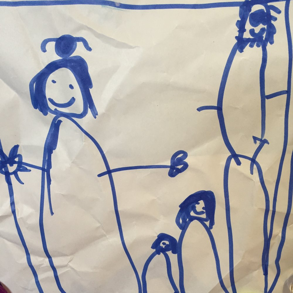 This is a cute portrait of our family drawn by our four year old daughter. I'm the one with the 'Mum bun'.
