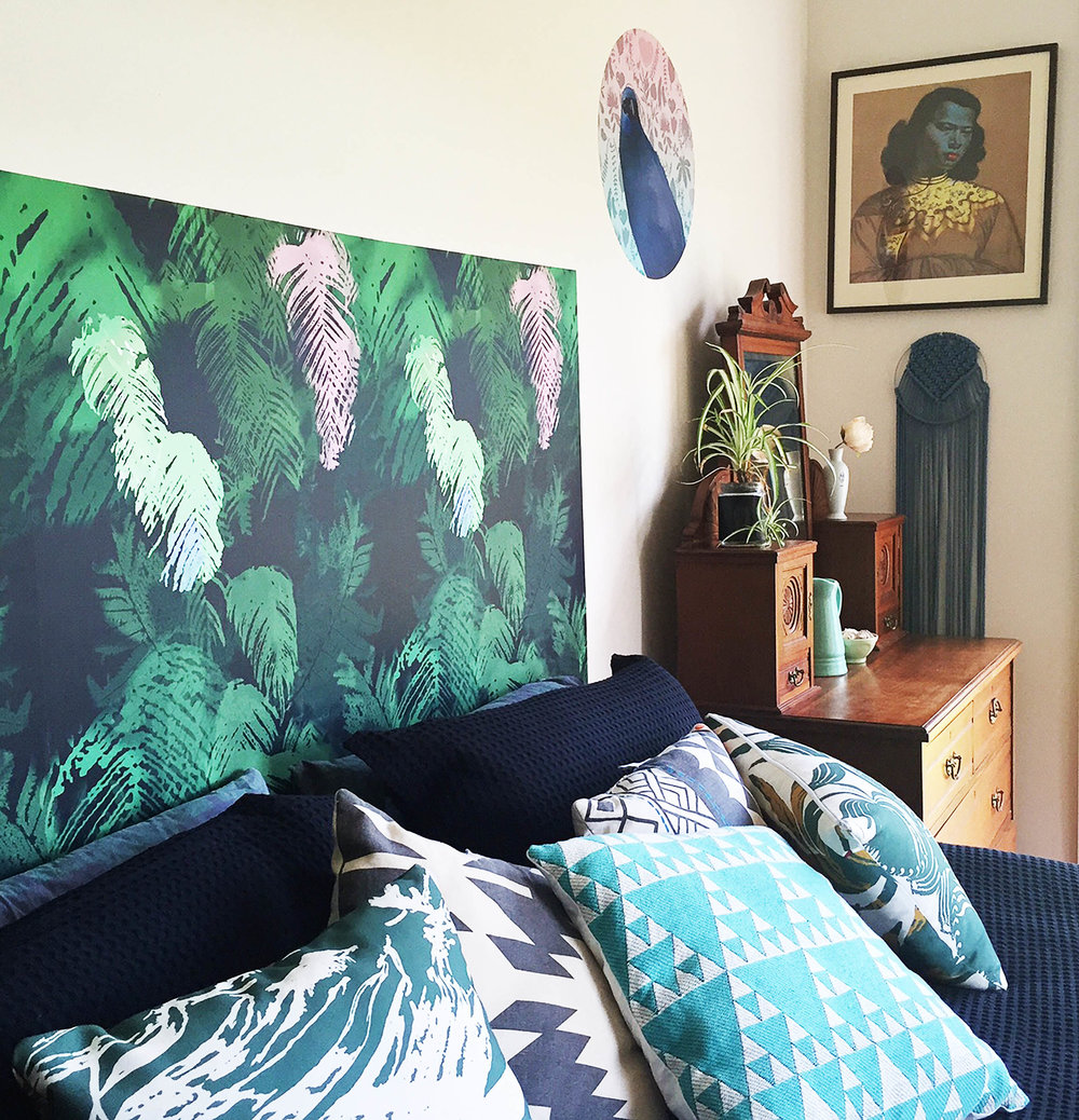 This was our first wallpaper headboard with my NZ ferns design. This suited our bedroom at the time because it was a really light space and we could get away with quite heavy furniture, black bedding and a dark headboard feature.