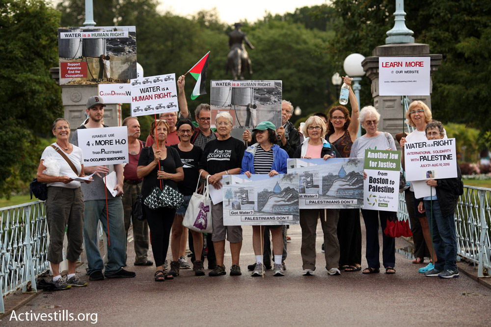 At the Boston Public Garden this summer where we were participating in a world-wide solidarity action. Photo Credit: Tess Scheflan