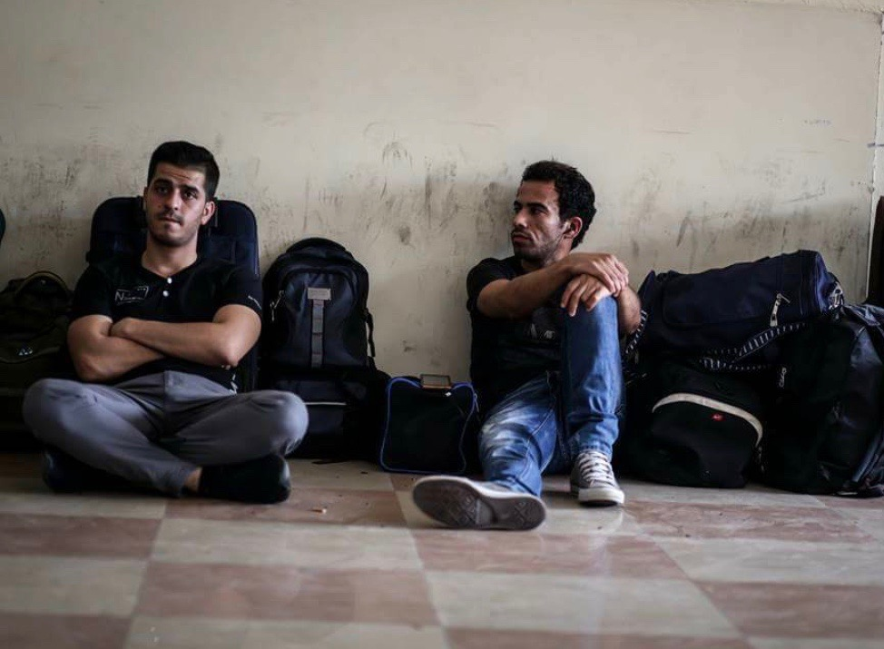 Said Al-Yaaqoubi, left, waiting at Rafah Border Crossing. His story is told in this article.