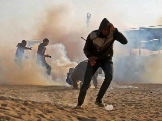 Palestinian protesters flee from tear gas during the demonstrations on Monday (AFP/Getty)