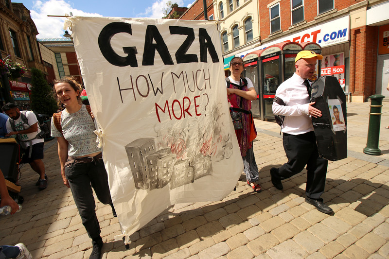 Activists protest in Oldham, England, in solidarity with Gaza on 7 July. (Ahmad Al-Bazz/Active Stillls