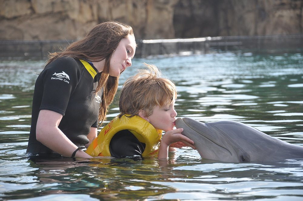 kissing a dolphin is so much sweeter when you're missing school                                photo by Discovery Cove staff photographer