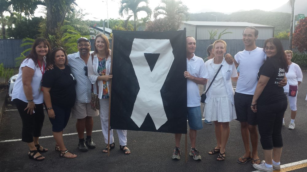 The Mossman Youth Centre's white ribbon banner representing at the 2016 twilight walk