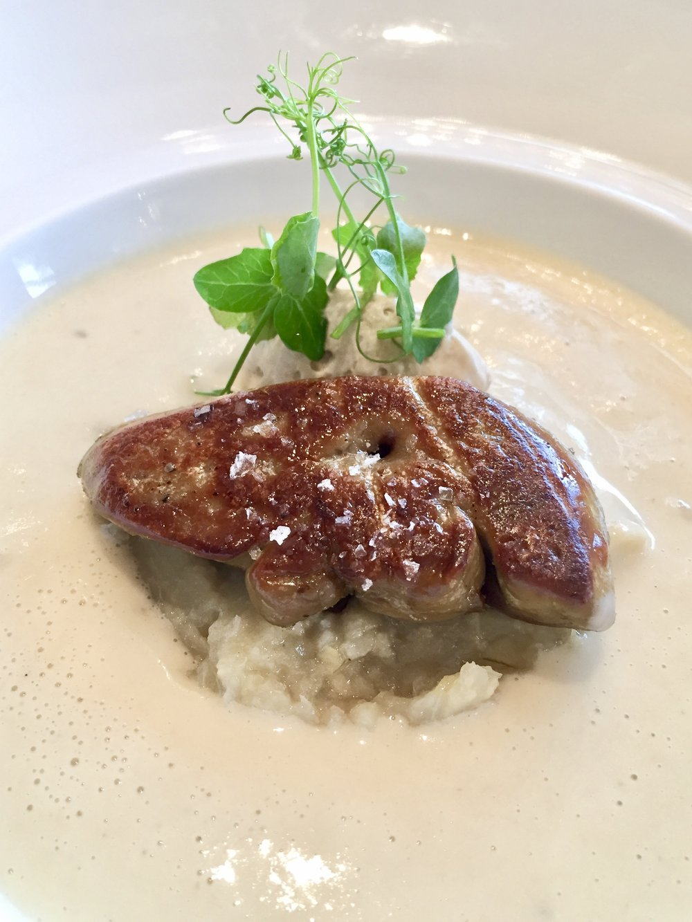 Brittany artichoke velouté, pan seared duck foie gras, black truffle emulsion.
