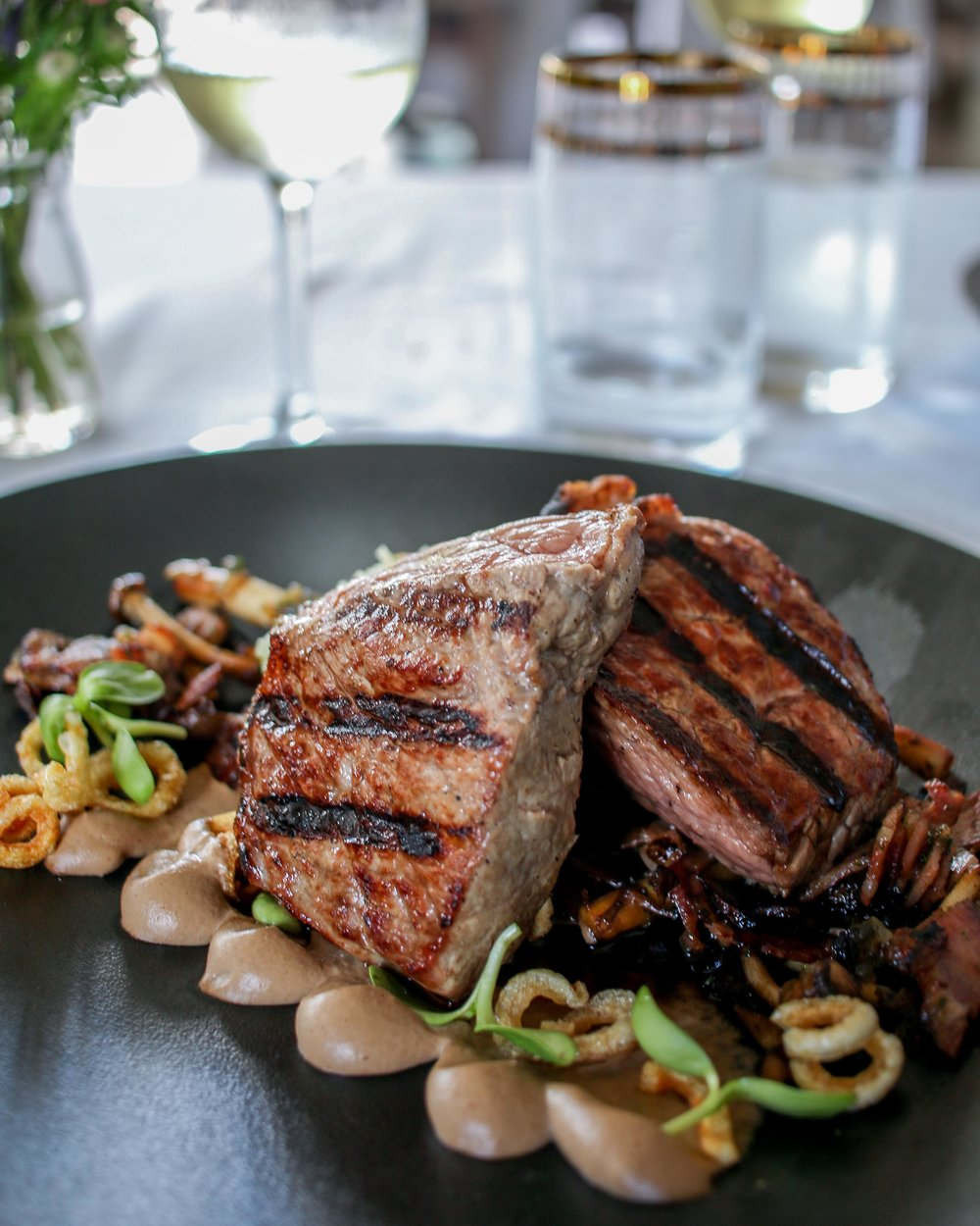 Sirloin steak, crackling, porcini puree, caper & brie crushed baby potato, sautéed mushroom, caramelized onion & bacon, red win jus