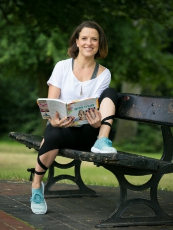 This is me - Meg - your teacher. I do things like read yoga books in the park. Y'know - as you do...