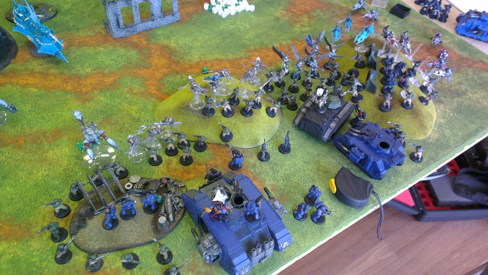 The attacking Space Marines find themselves attacked instead by the evil, treacherous Dark Eldar. Just one of the many action scenes happening at Objective Secured @ South Perth Community Hall on Sunday. (Photo credit: Mine)